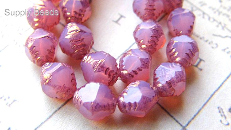 Satin Pink Beads,  https://www.etsy.com/shop/SupplyBeads/search?search_query=bicone&order=date_desc&view_type=gallery&ref=shop_search