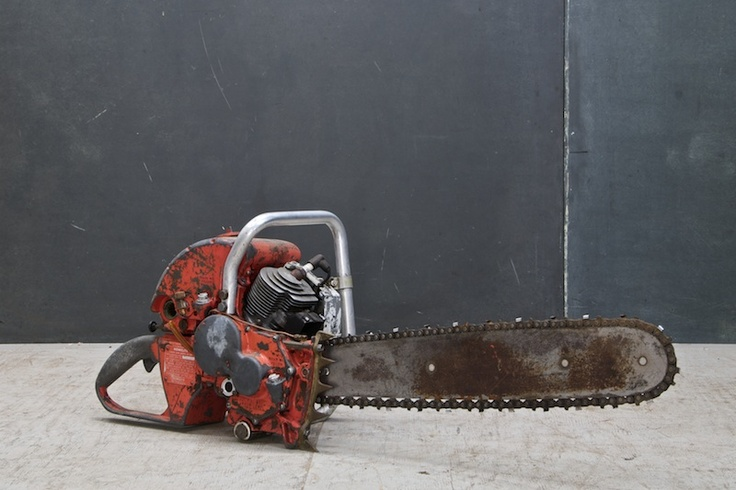 vintage industrial homelite chainsaw red patina, and age.
