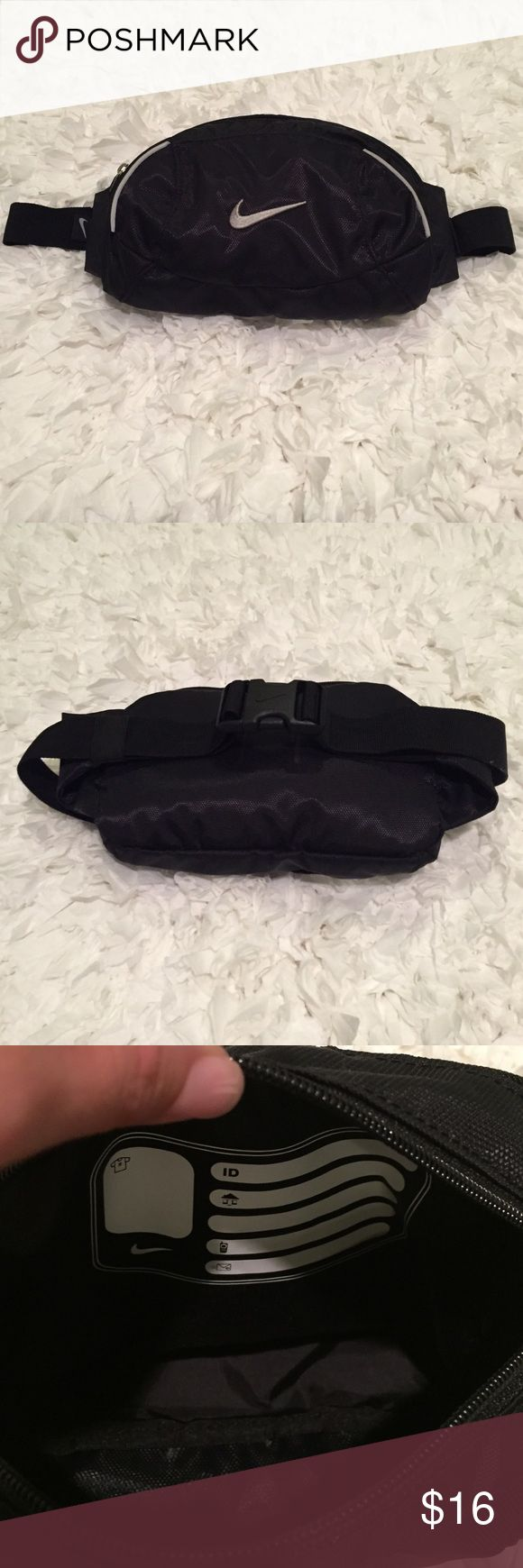 Unisex Nike Fanny Pack Unisex Nike Fanny Pack. Gently used once. EUC. Black with gray trim & gray logo on front. Adjustable with snap closure. 2 zip close pockets with 1 having a place to write your info on it if u choose & a clip to keep your keys. Great for when u exercise, run & great to pack for vacations! 100% nylon. Wipe clean with a damp cloth. NO TRADES. Nike Bags