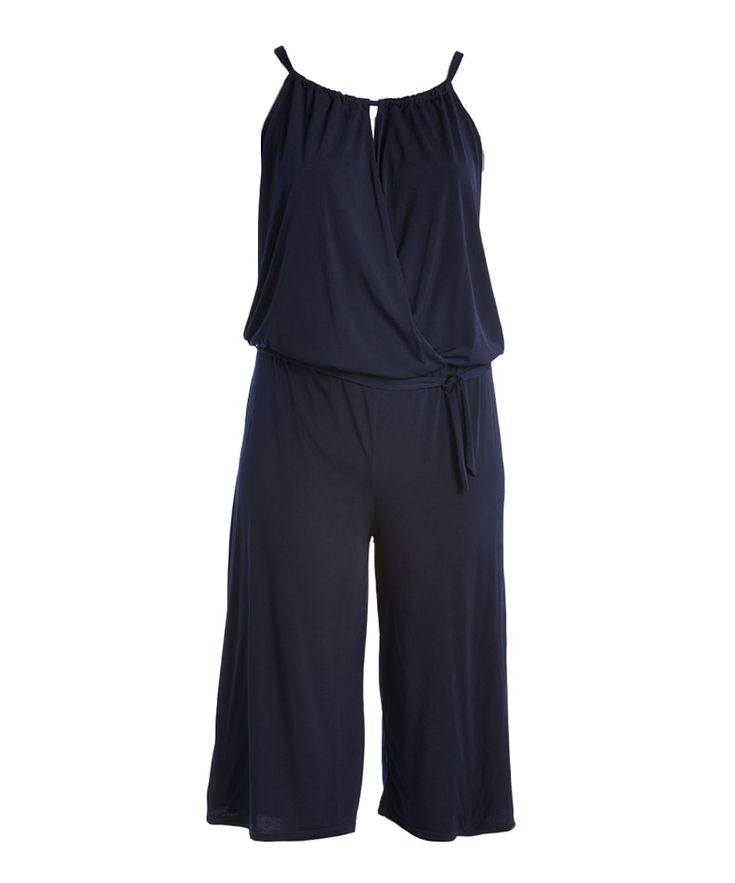 """Bring all-day comfort to your ensemble with this jumpsuit crafted from stretch-kissed material. A keyhole cutout accents a surplice neckline with subtle skin-baring style.1X = 14W – 16W, 2X = 18W – 20W, 3X = 22W – 24WSize 1X: 55'' long from high point of shoulder to hem; 19'' inseamMannequin: 5′ 9"""" tall; 45"""" chest; 36"""" waist; 46"""" hips94% rayon / 6% spandexHand wash; dry flatMade in the USA"""