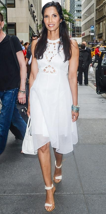 Look of the Day › June 26, 2014 Padma Lakshmi embraced summer whites as she stepped out in a breezy broderie LWD, styling it with an arm party stack of bangles, a ladylike tote, and ankle-strap sandals.