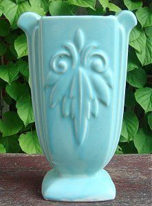 ❥ McCoy Pottery vase~ have some...want more.  Cream color please.