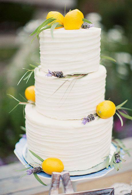 Three Tiered White Wedding Cake With Lemons
