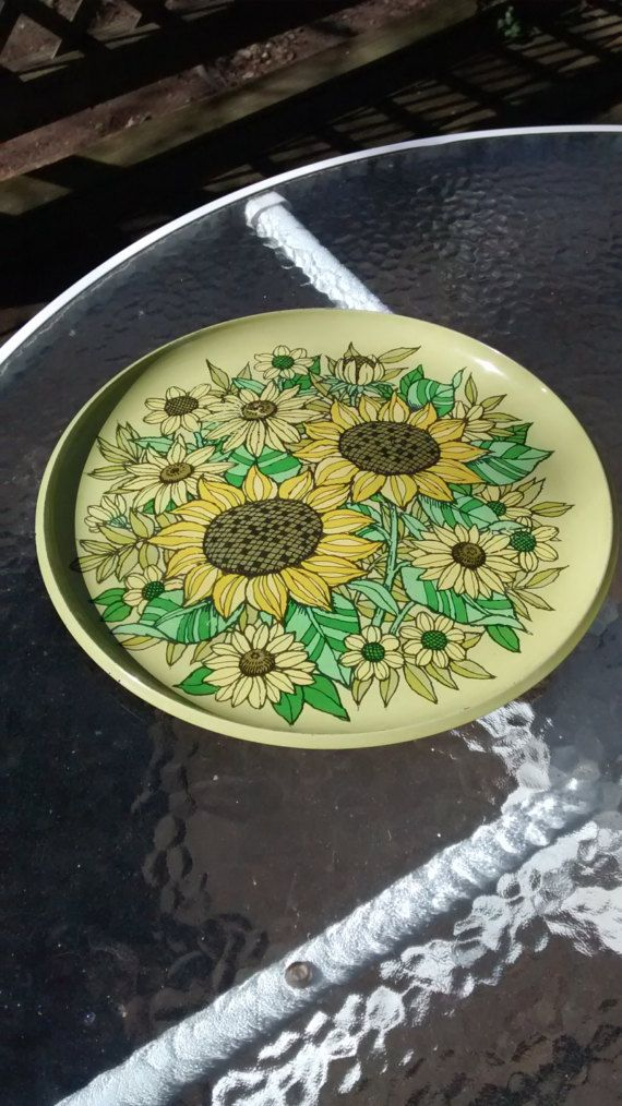 Check out this item in my Etsy shop https://www.etsy.com/listing/500071836/sunflower-tray-vintage-plastic-tray