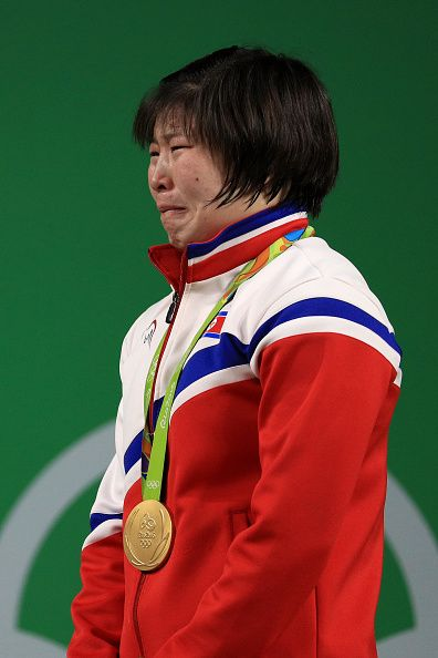 Gold medalist Jong Sim Rim of North Korea cries on the podium during the medal…