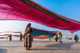 Indian pilgrims drying their colorful sarees under sun stock photo
