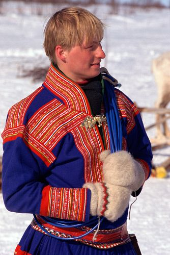 Sami man wearing traditional clothes at Easter Reindeer races. Kautokeino. Norway.