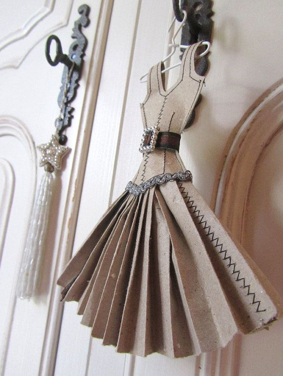 stylish dress miniature is made from pages from recycled paper