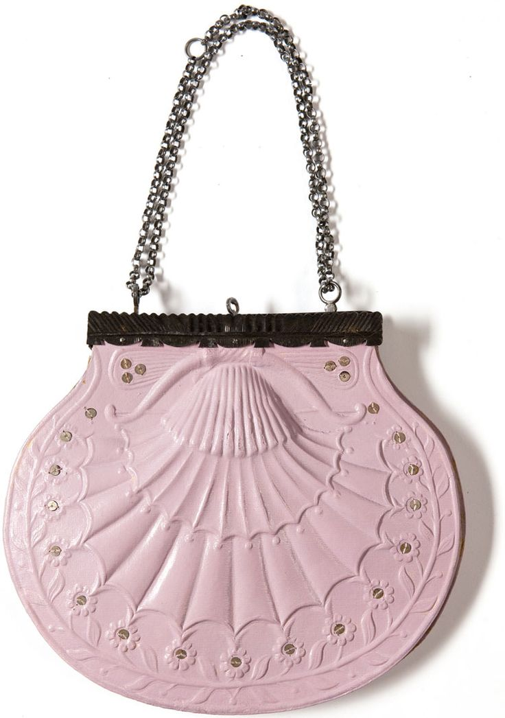 A French handbag, c.1820; in this context, the pink scallop shell could be considered a symbol of marine fertility, and of the Graeco-Roman goddess Aphrodite/Venus, whose attributes included a scallop shell. (www.lesartsdecoratifs.fr)