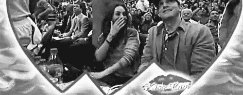 Parents-to-be Mila Kunis and Ashton Kutcher on the kiss cam.