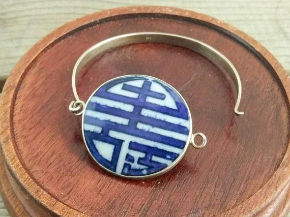 Sterling silver and porcelain shard bracelet.  https://www.etsy.com/listing/554253219/chinese-silver-and-porcelain-bracelet
