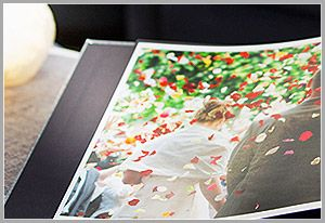 albumworks: Personalised Photo Books, Calendars & more. Except they dont seem to have flat pages in order to have a photo displayed over 2 pages & being seemless! Thats what i want!