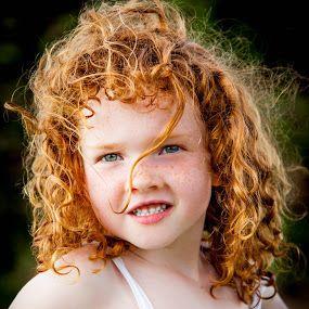 tawny ginger curls