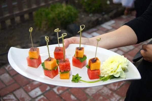 Fresh melon skewers with basil olive oil and balsamic vinegar (perfect for a summer wedding) | 8 Sustainable Wedding Appetizer Ideas From Eco Caters | Green Bride Guide