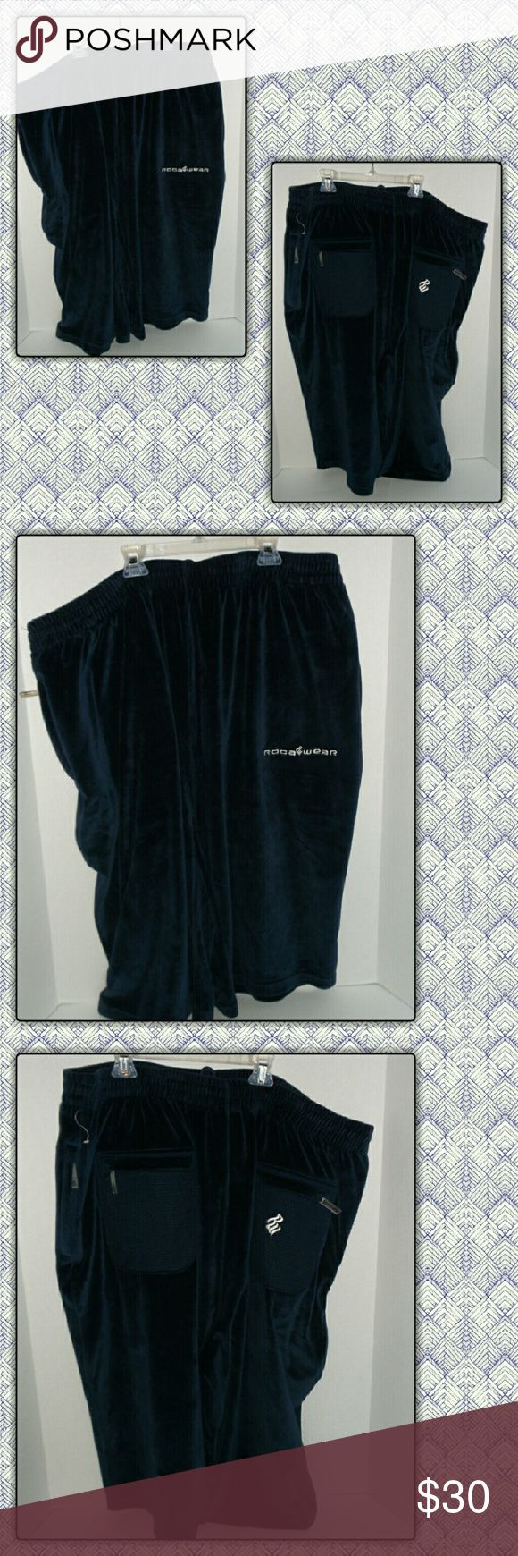 Men's Roca Wear velour shorts NWOT men's rocawear velour shorts. That go past the knee has plenty of pockets Rocawear Shorts