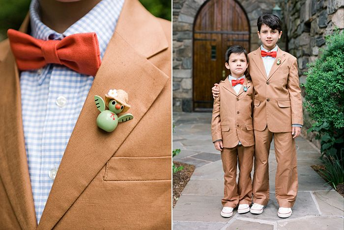 Charming ring bearers with red bowtie, blue gingham button up and creamy brown suit.  Photo: Erik Ekroth