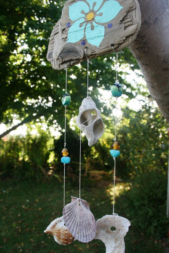 Hey, I found this really awesome Etsy listing at http://www.etsy.com/listing/130735411/plumeria-shells-glass-beads-wind-chime