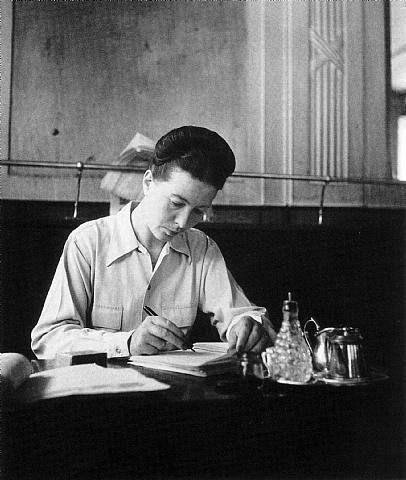 Simon de Beauvoir at Cafe Les Deux Magots (by Robert Doisneau)