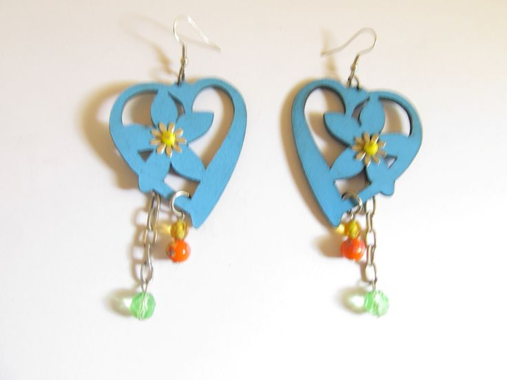Handmade laser cut leather earrings (1 pair)  Made with turquoise leather heart, metallic flower and glass beads.