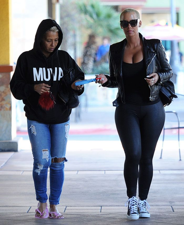 Amber Rose Squeezes Ample Assets into Tank Top and Leggings Combo and Chuck Taylor Converse All Star Shoes