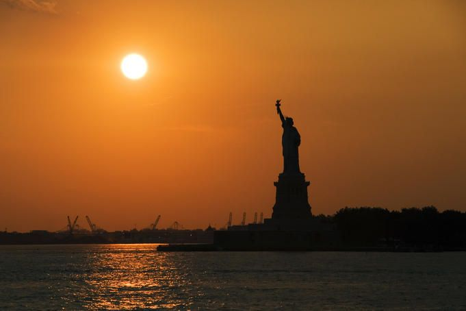 Statue of Liberty at sunset, seen from the Staten Island Ferry.  Photo by Rachel Lewis a Lonely Planet Photographer.