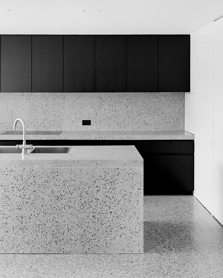 ROLIES + DUBOIS kitchen in black wood and terrazzo