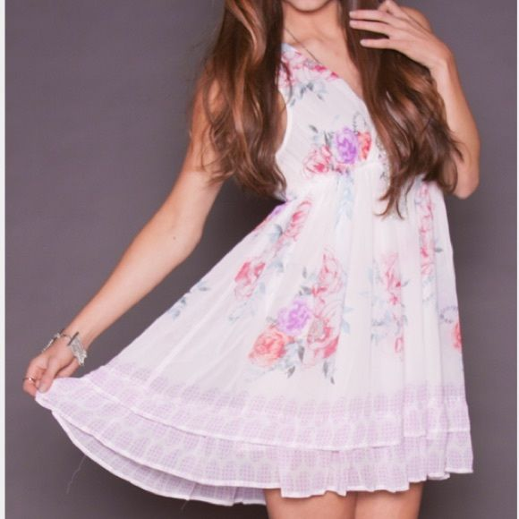 """NEW Free People """"printed spring fever"""" dress Beautiful Free People dress in perfect condition! Got from a last chance store, however the bust is too big for me, I have never worn it! Free People Dresses"""