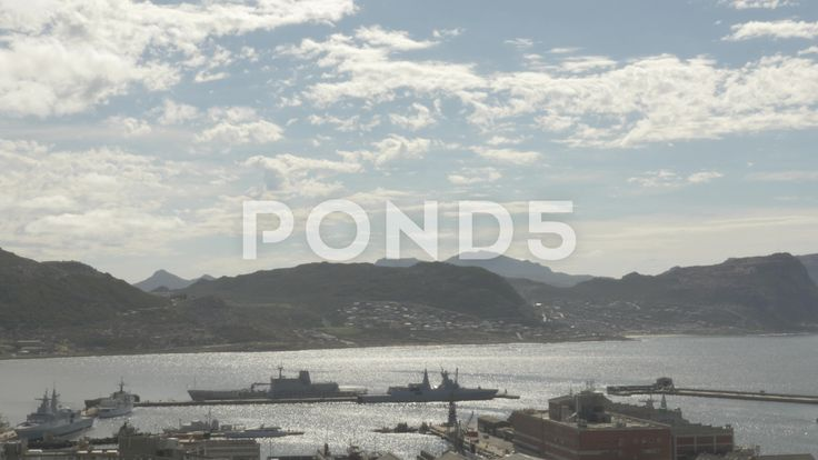 4k Ships at Naval Dockyard Pier Ocean Beach Mountains - Stock Footage   by RyanJonesFilms