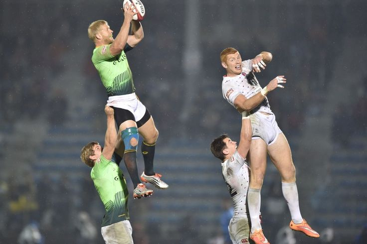 Week of Apr 4-10, 2015 South Africa's Kyle Brown, top left, and England's James Rodwell, top right, fight for the ball during their final match at the Tokyo Rugby Sevens on Sunday. England won the final 21-14. KAZUHIRO NOGI/AGENCE FRANCE-PRESSE/GETTY IMAGES