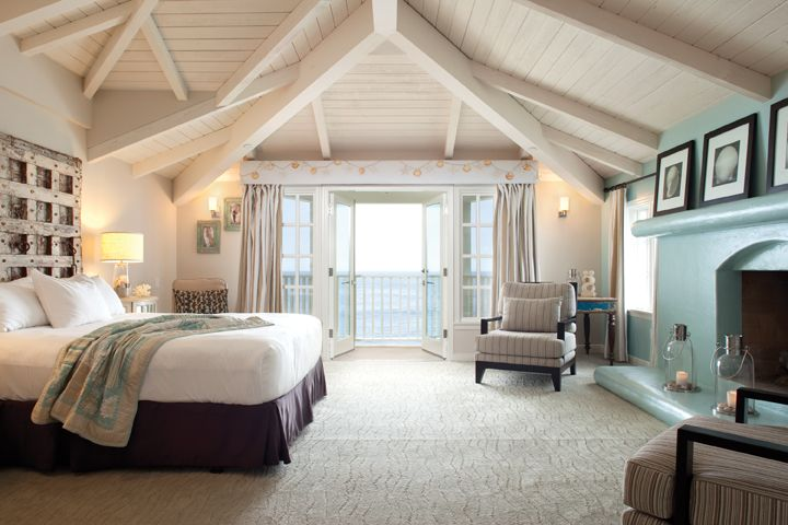 The Pacific Suite at the Pacific Edge Hotel features a king bed and additional bedroom overlooking the ocean and adjacent to The Deck restaurant, decorated with beach-chic furnishings and art. #travel #lagunabeach #california