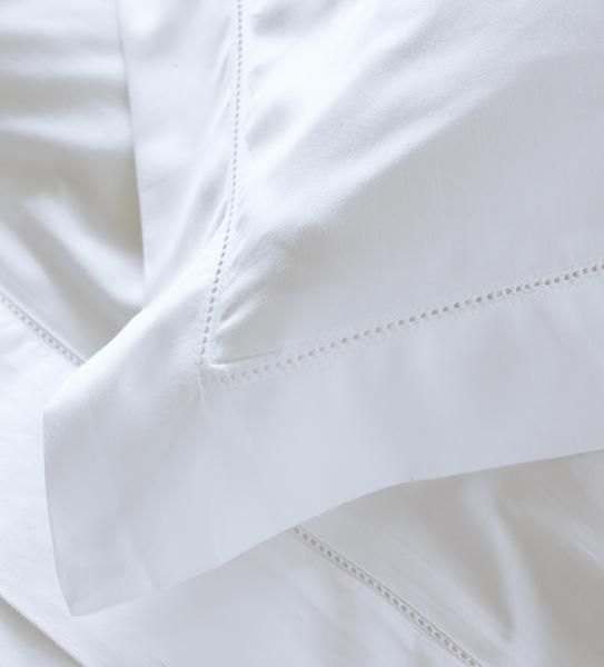 Calvi Ever so luxurious. 300 thread count 100% cotton. Avail in white, hemp and blush hues, this cotton bed sheet and pillowcase feels gloriously soft and crisp