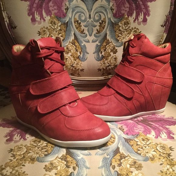 Red Wedge Sneakers NEW! Brand New in box, Super Cute Red Wedge Sneakers!! Add some height and color to your outfit with these fabulous super comftorable sneakers!! Shoes Wedges