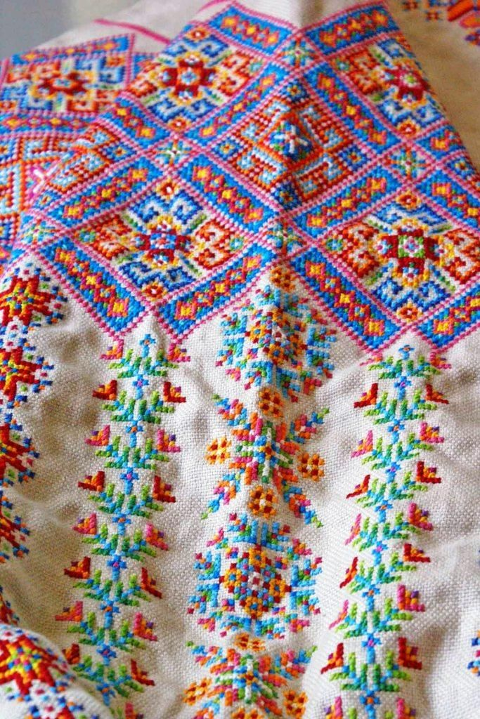 Upper sleeve and shoulder of a Ukrainian 'sorochka', or shirt, that I designed and embroidered in a style with motifs and patterns inspired by the traditional shirts and blouses from Serafyntsi village of Horodenka region in Carpathian Western Ukraine (Designed, embroidered, and assembled by Dave Melnychuk)