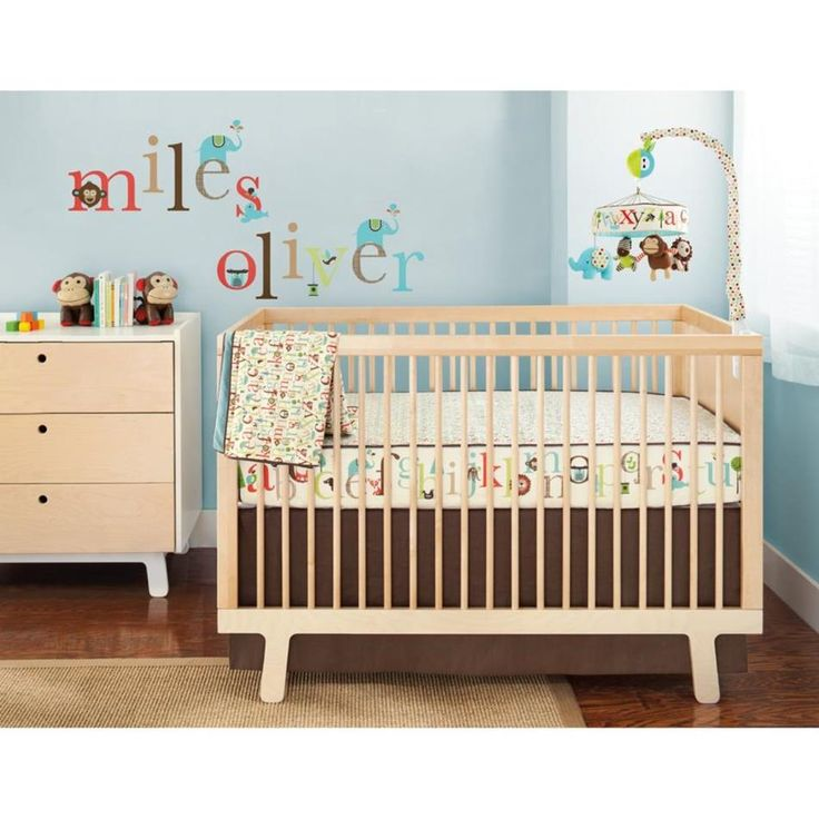 Cute Modern Baby Cribs for Boys and Girls : Fascinating Beige Modern Unisex Baby Crib Design with Beige Desk Drawers and Tan Synthetic Carpet also Letters and Animals Wall Sticker