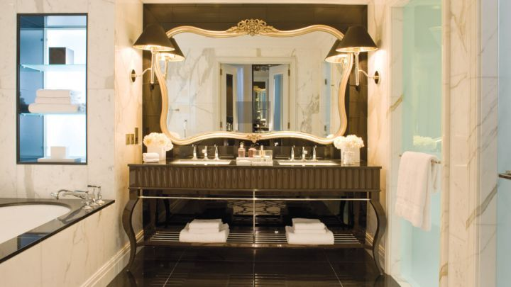 Relax in @Four Seasons Hotel Baku, Azerbaijan master bathroom with double vanities, hidden television, deep soaking tub and rain shower.