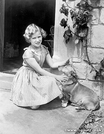 Princess Anne with the #Corgi at Windsor. 27th November 1959