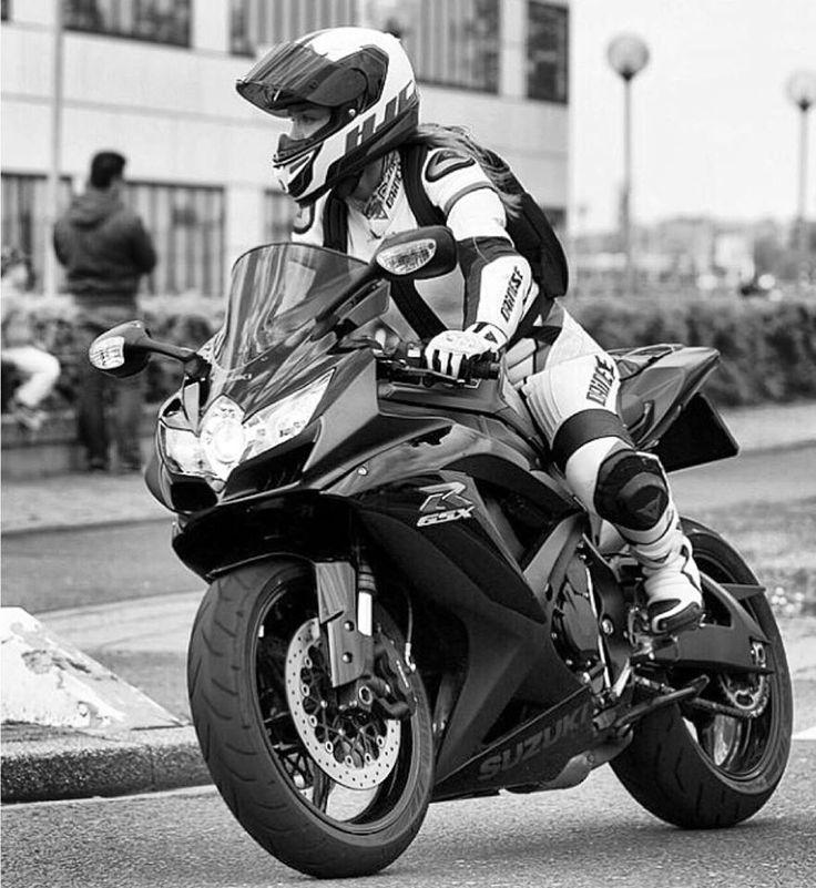 Black and white shot of biker woman on street bike