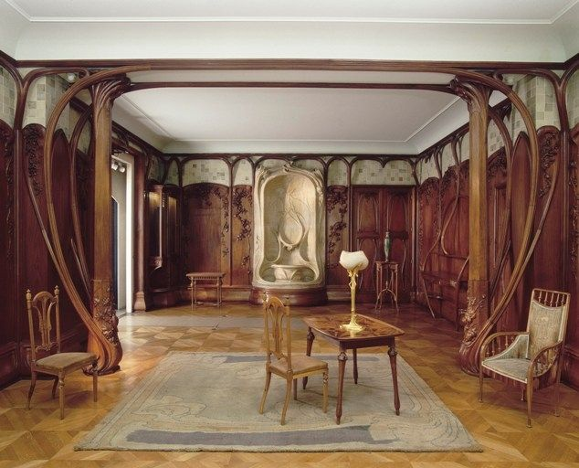 Alexandre Charpentier (1856-1909) - Dining Room Set. Mahogany, Oak and Poplar; Metalwork of Gilt Bronze; Flower Stand of Enamelled Stoneware. Circa 1901. Designed for the Banker, Adrien Bénard in Champrosay. Musée d'Orsay