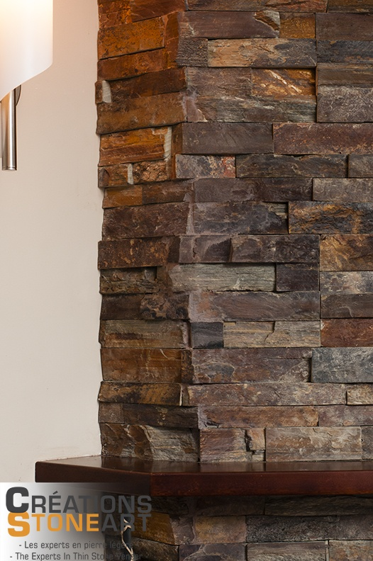 Fireplace done with Terracotta Ledgestone from Realstone Systems. Corner detail.
