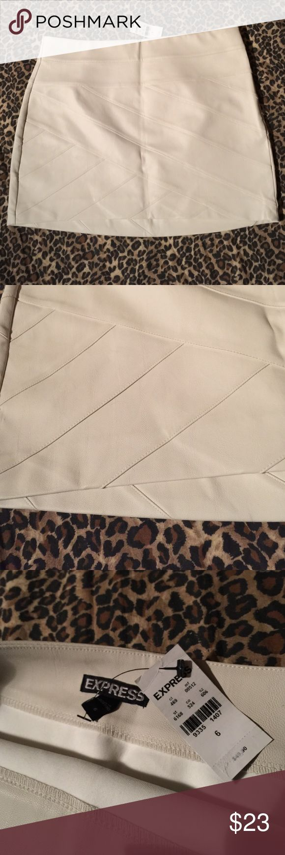 EXPRESS beige/cream faux leather skirt sz. 4 NEAT New with tags! (Retail $49.90) This is really stylish & neat!! A women's size 6 EXPRESS beige/cream faux leather dressy skirt! Above the knee (measures approx. 13.5 in. In the front & approx. 14.5 in in the back) a NEAT patchwork lined design this is super comfy soft like faux leather & is a satin like inside lining. This zips up the side (hidden) & is just pretty pretty!! A great skirt for fall & winter & would look great w/your favorite…