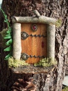 Elf door on tree! Use popsicle sticks and old jewelry. garden ideas