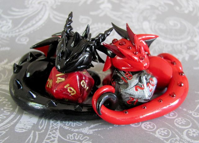 Adorable sculpted dragons guard your 20-sided dice...Magic the gathering...
