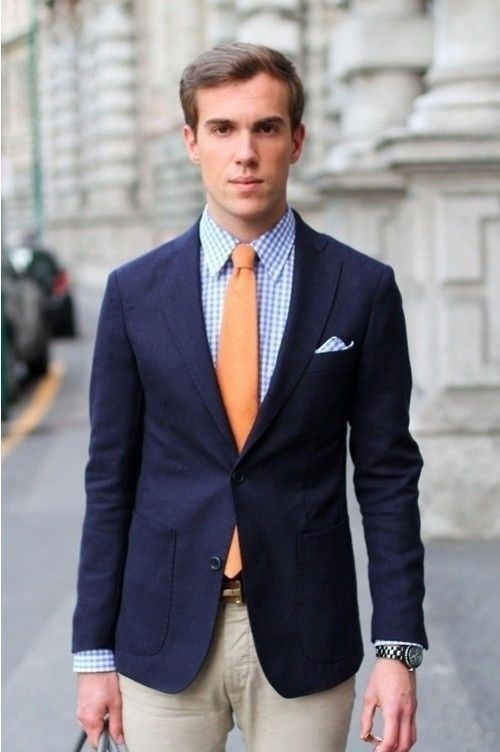 Shop this look for $186:  http://lookastic.com/men/looks/tie-and-blazer-and-pocket-square-and-dress-shirt-and-dress-pants/231  — Orange Tie  — Navy Blazer  — Blue Gingham Pocket Square  — Blue Gingham Dress Shirt  — Beige Dress Pants