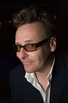 """Gregory Everett """"Greg"""" Proops (born October 3, 1959) is an American actor, stand-up comedian and television host. He is widely known for his work as an improvisational comedian on the UK and U.S. versions of Whose Line Is It Anyway?. (Guest Just A Minute)"""