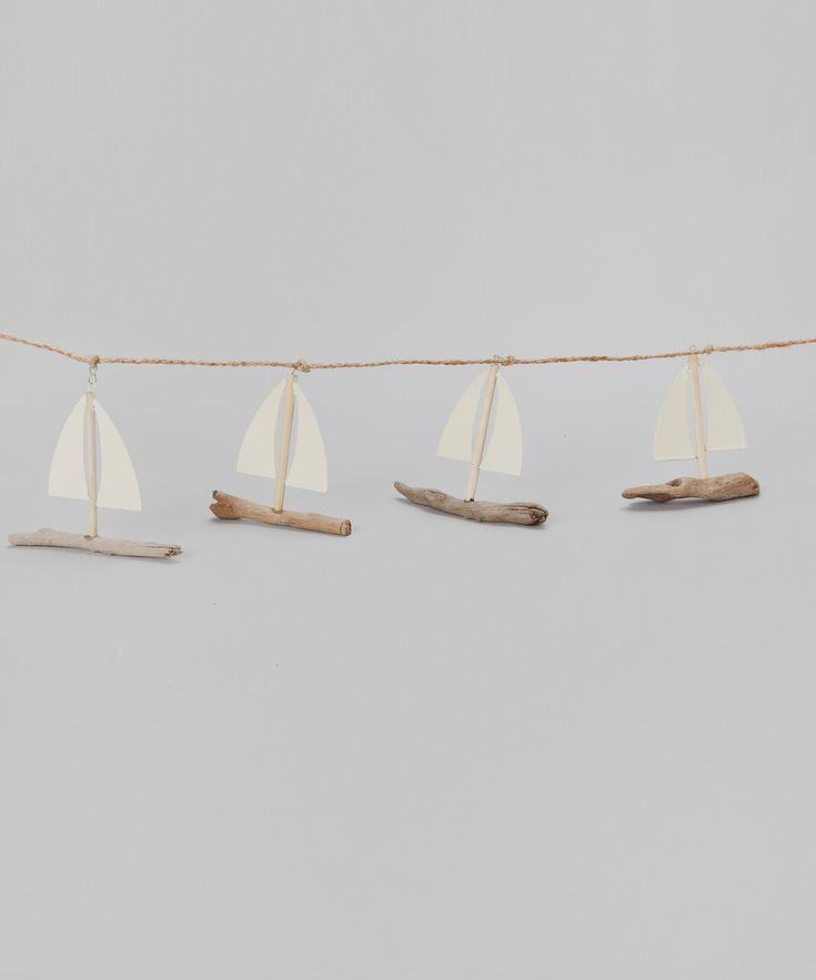DIY inspo: petits bateaux garlande. Now I know what to do with all that driftwood I picked up in Devon last week!