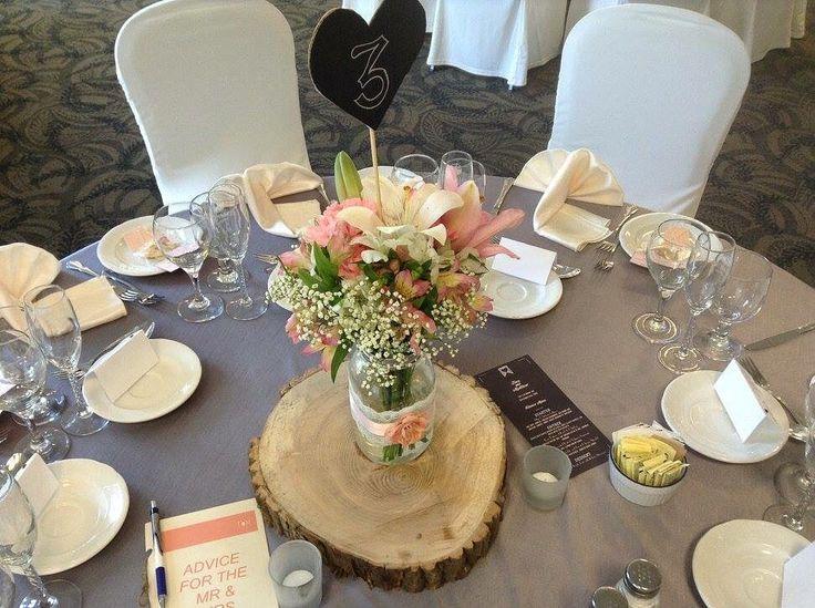 Florals by High Gloss Weddings • www.highglossweddings.com • lilies, alstroemerias, baby's breath, mason jars & wood cuts.