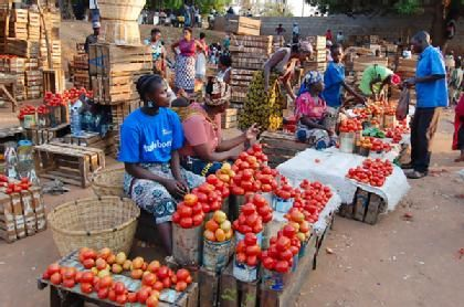 There are more sellers than buyers at the fruit and vegetable market in Chimoio, Mozambique, where food prices have soared out of reach of impoverished locals.
