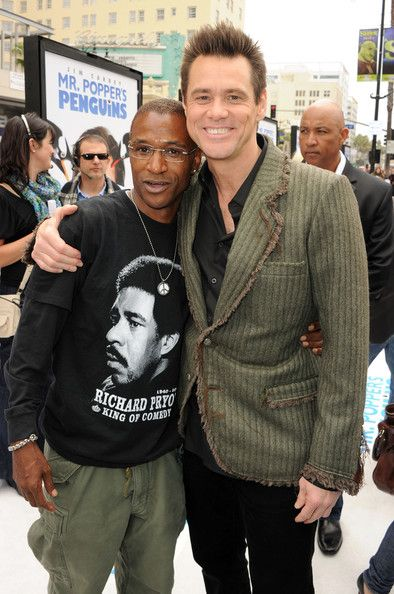 """Jim Carrey Photos - Actors Tommy Davidson (L) and Jim Carrey arrive at the premiere of 20th Century Fox's """"Mr. Popper's Penguins"""" held at Grauman's Chinese Theatre on June 12, 2011 in Hollywood, California. - Premiere Of 20th Century Fox's """"Mr. Popper's Penguins"""" - Red Carpet"""
