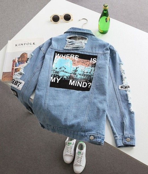 Distressed denim jacket with a giant back patch.