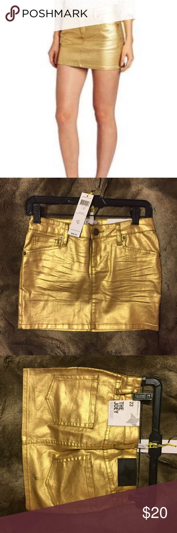BCBGENERATION gold skirt New with tags. Great condition. Last 2 pictures show the distress in the skirt. Not worn. Size: 23. Similar to XS BCBGeneration Skirts Mini